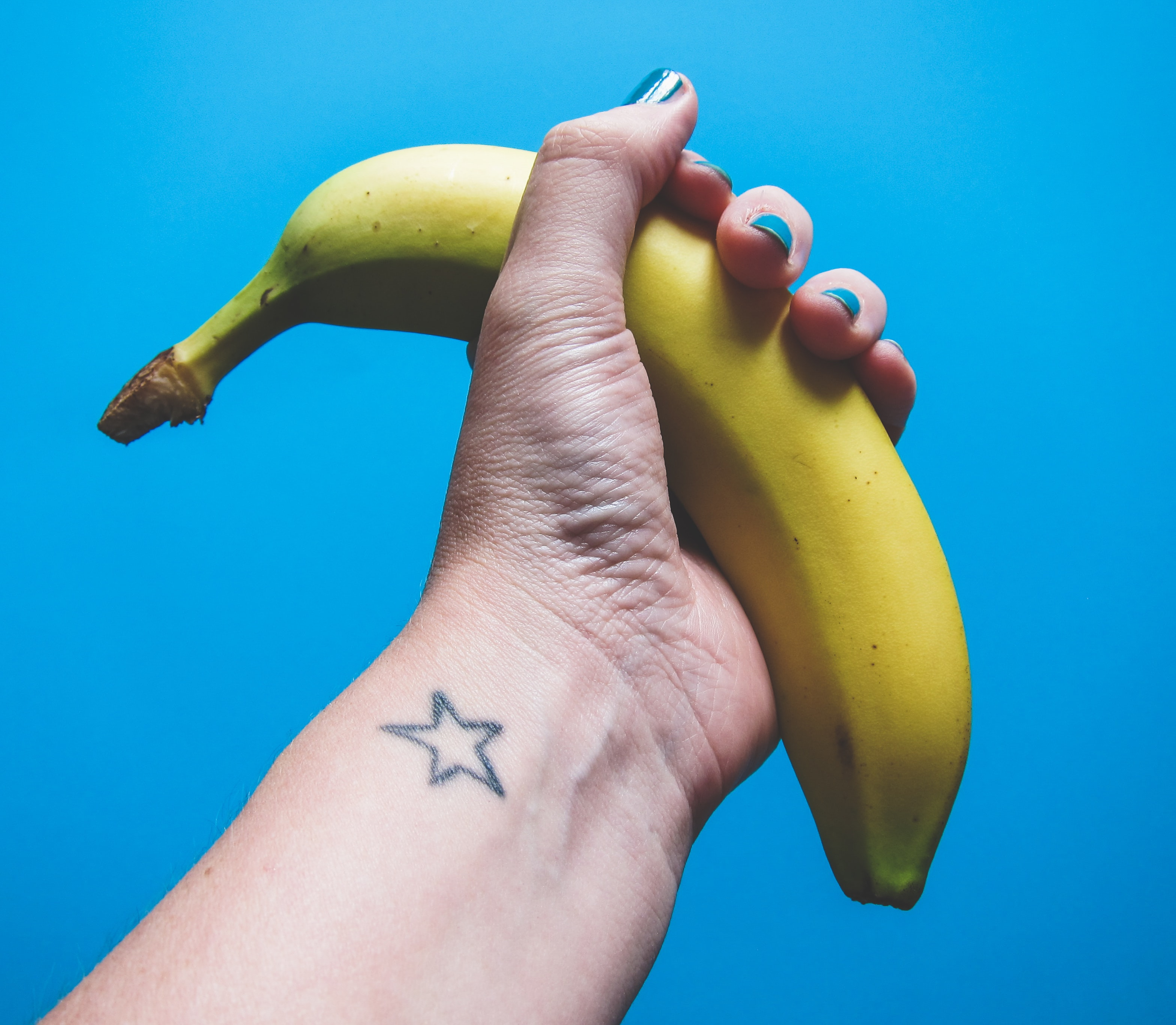 person holding ripe banana