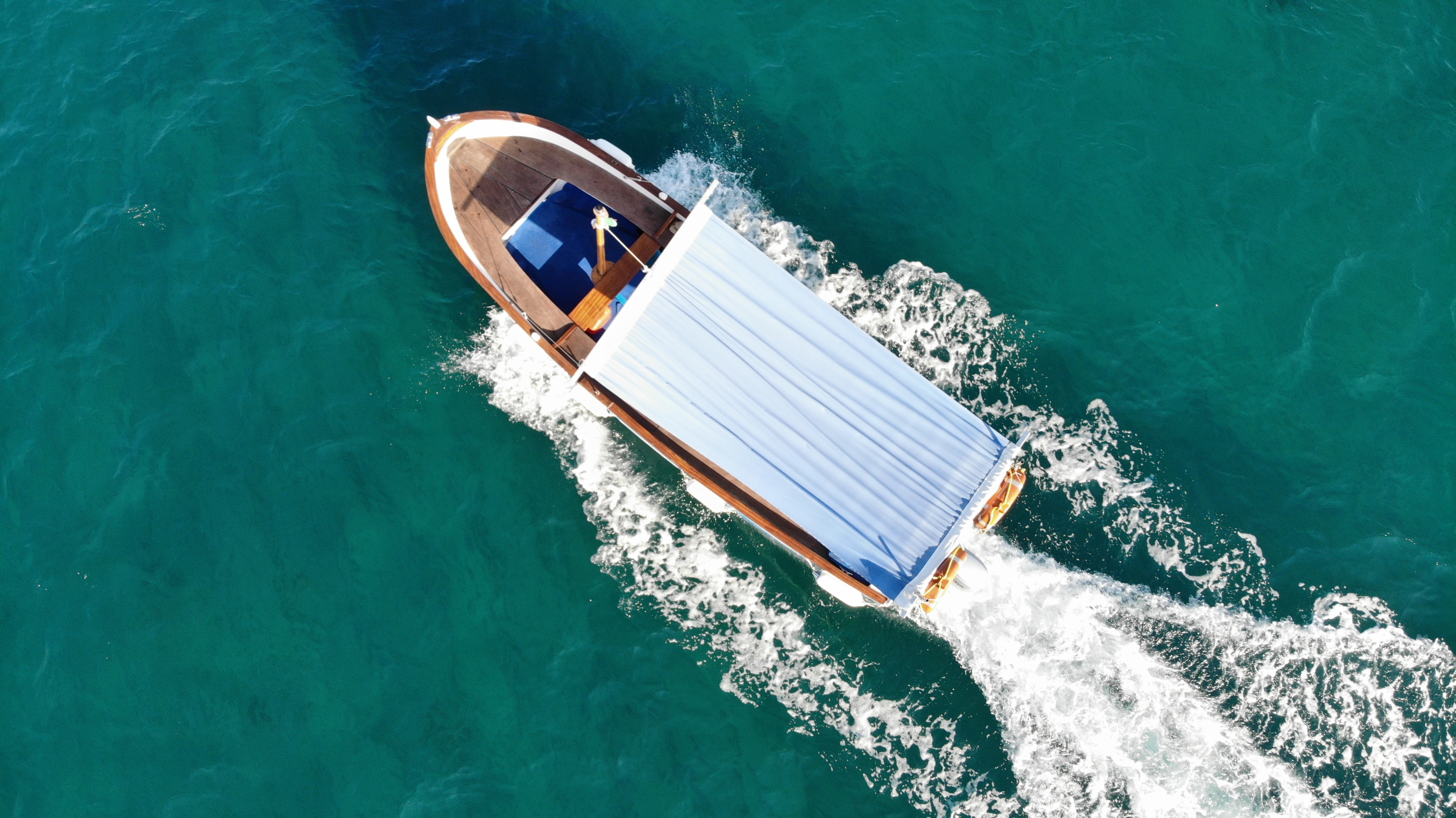 aerial photography of white and brown wooden boat