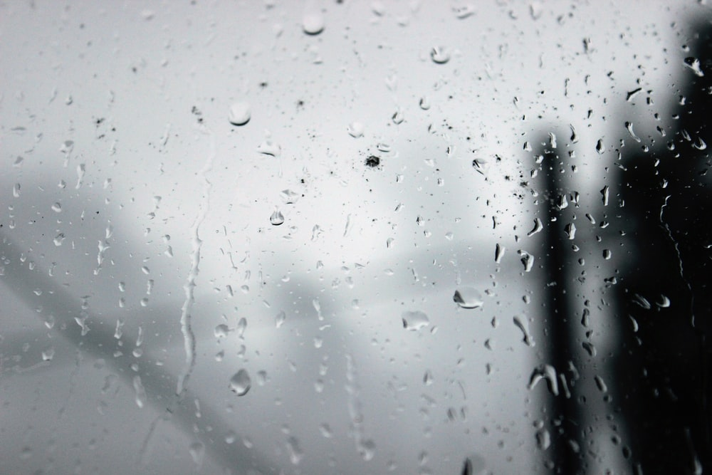 clear glass window with water droplets