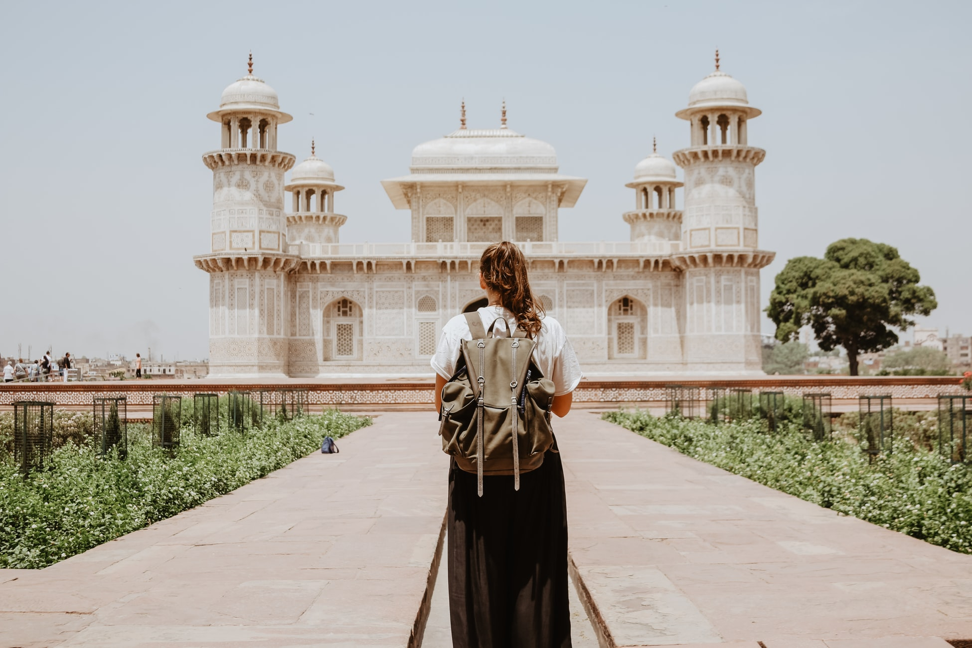A Girl Standing in front of a monument - A Little Game of Budget Travel