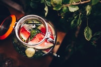 selective focus photography of mason jar filled with liquid