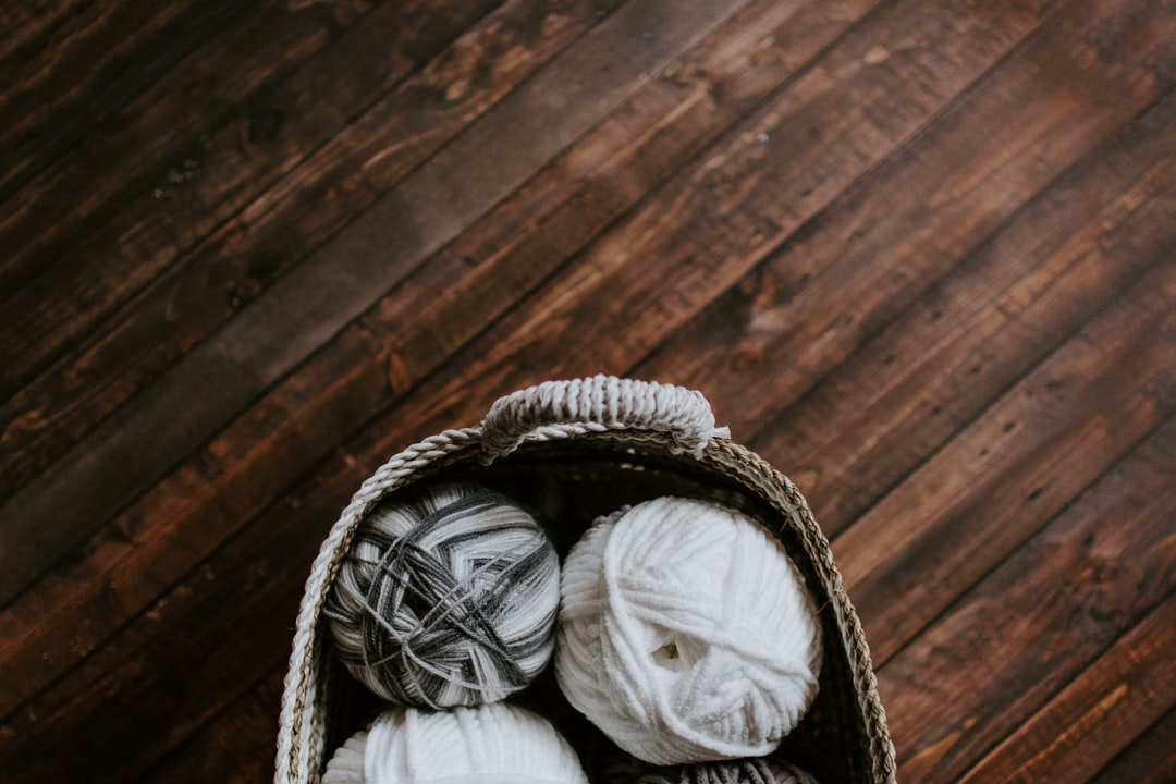 Basket of white and gray yarns