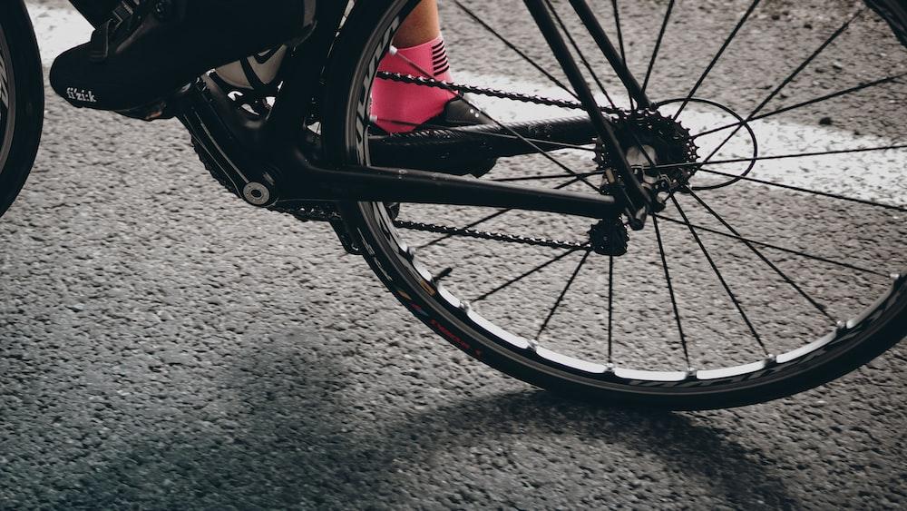 black bike wheel on road