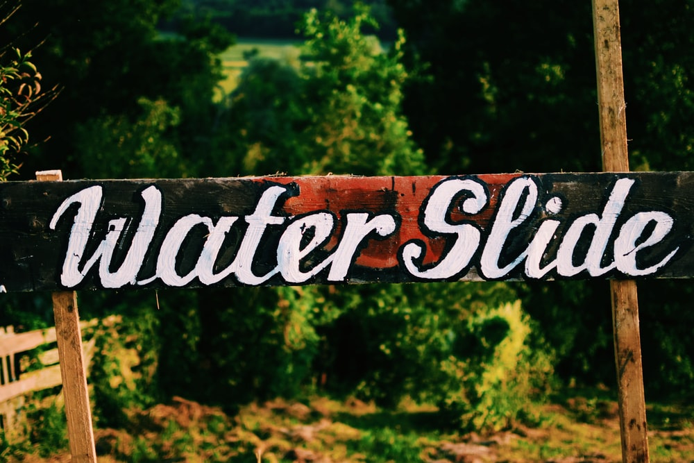 black and white Water Slide wooden sign