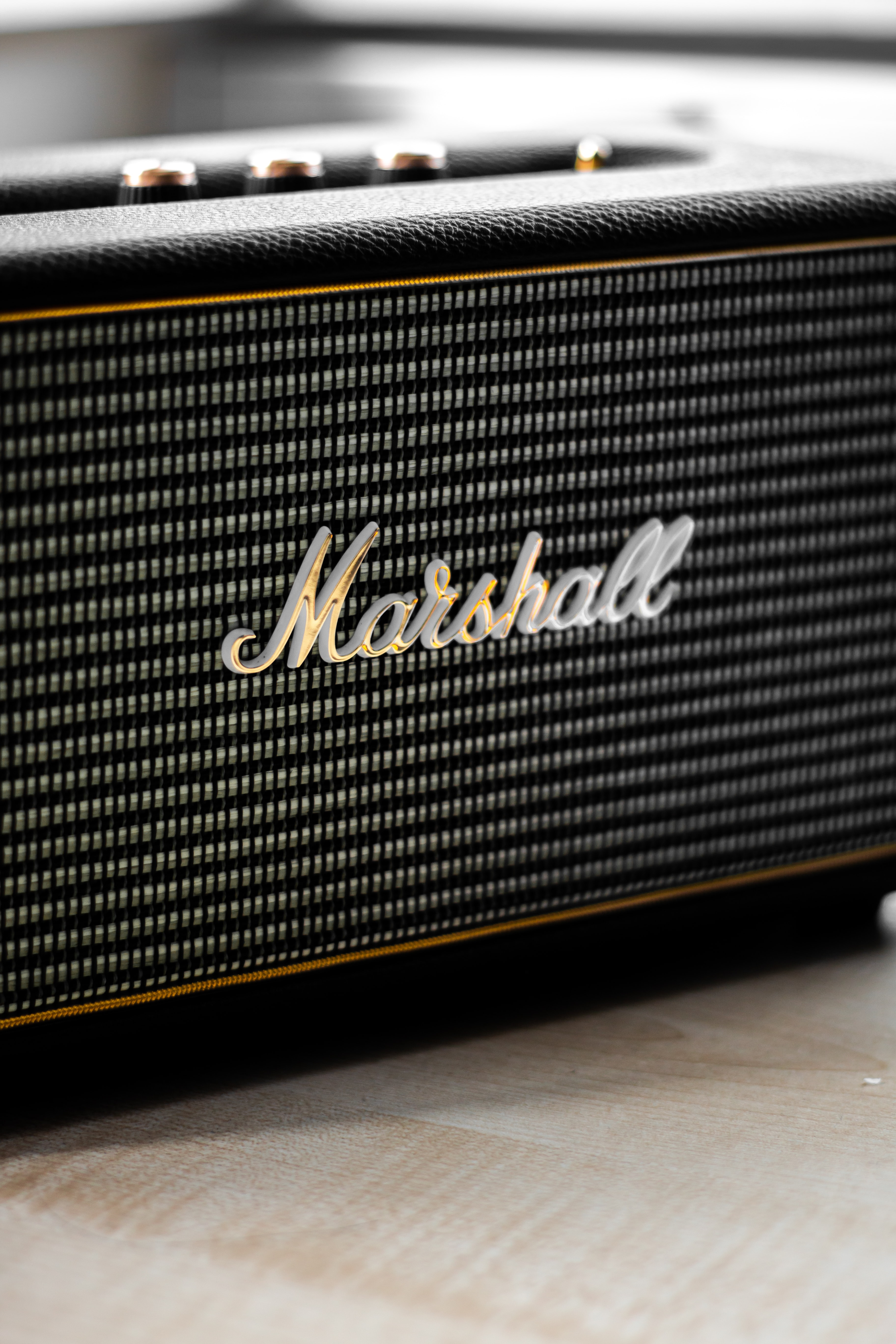 closeup photo of gray and black Marshall guitar amplifier