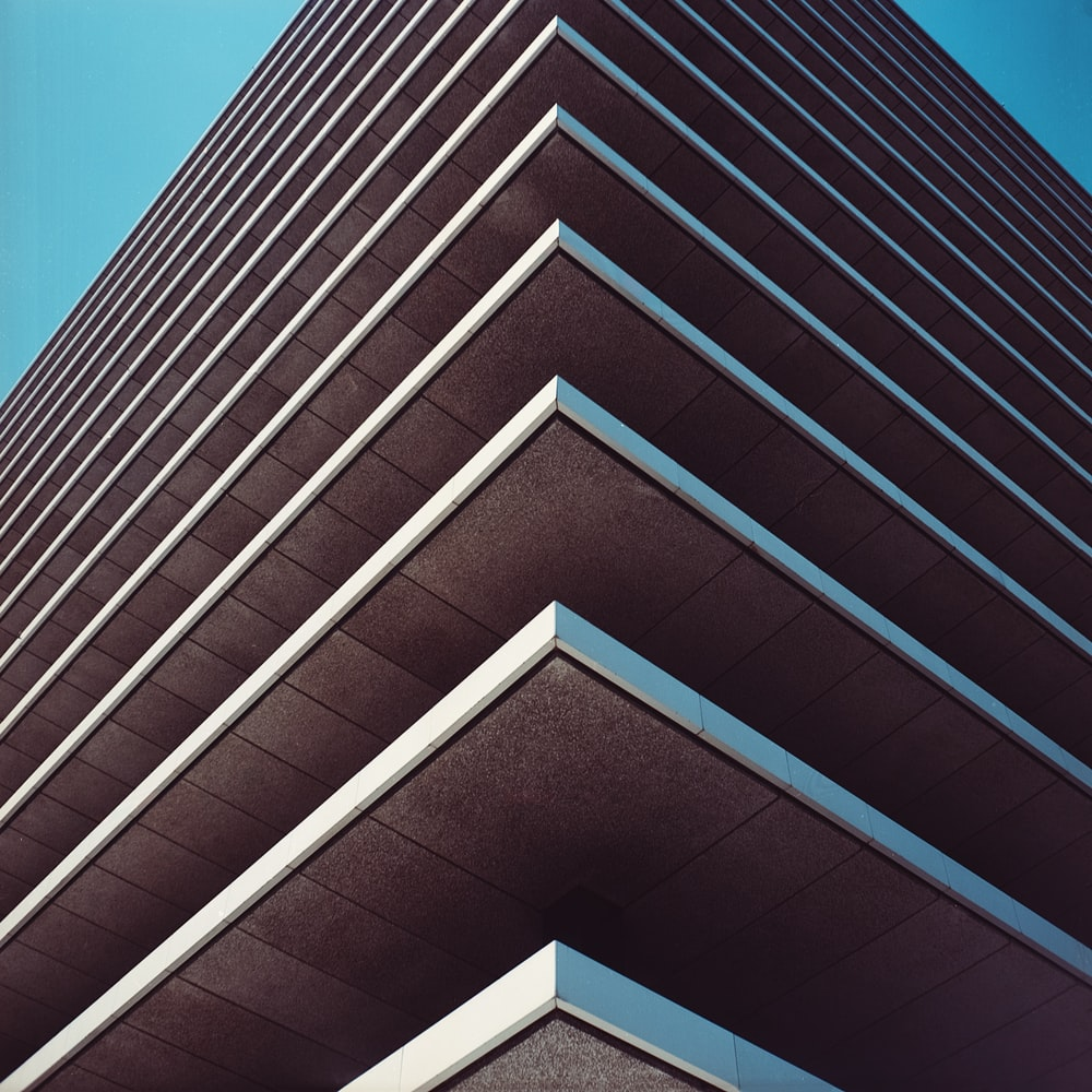 low angle photography of gray concrete building taken during daytime