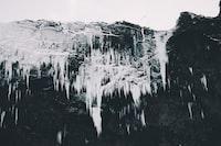 greyscale photo of cave stalagmites
