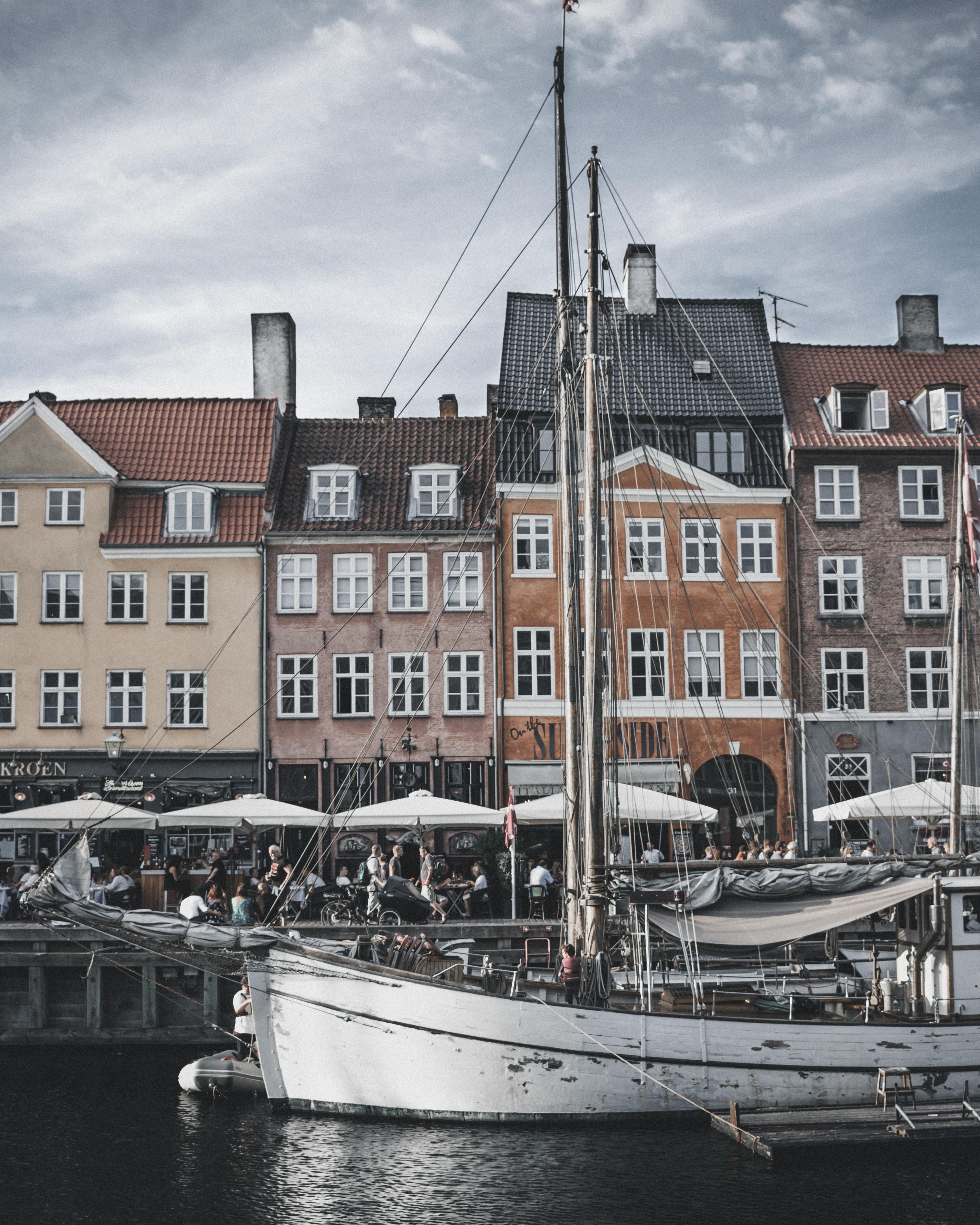 gray boat docked near houses