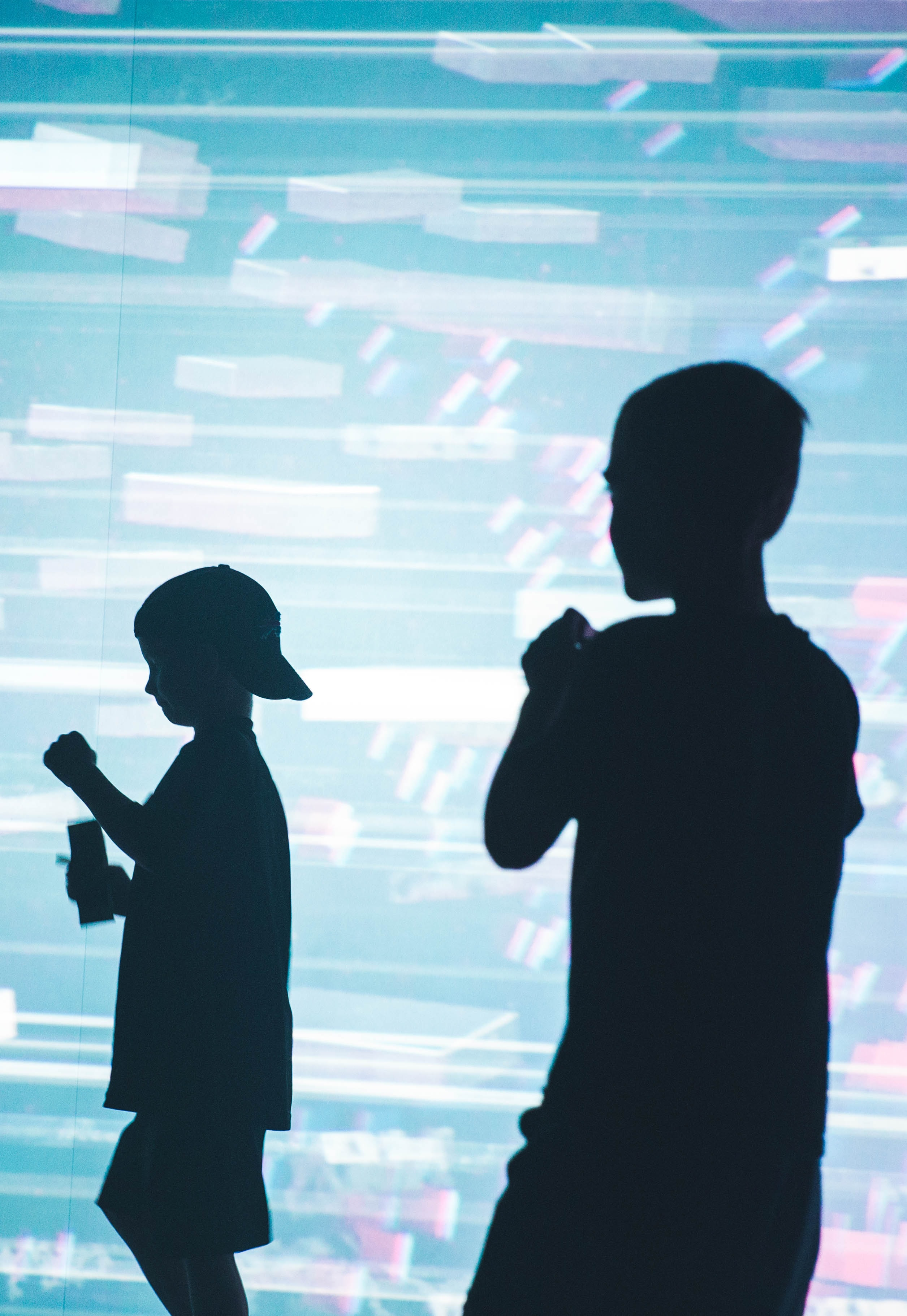 two silhouette of boys