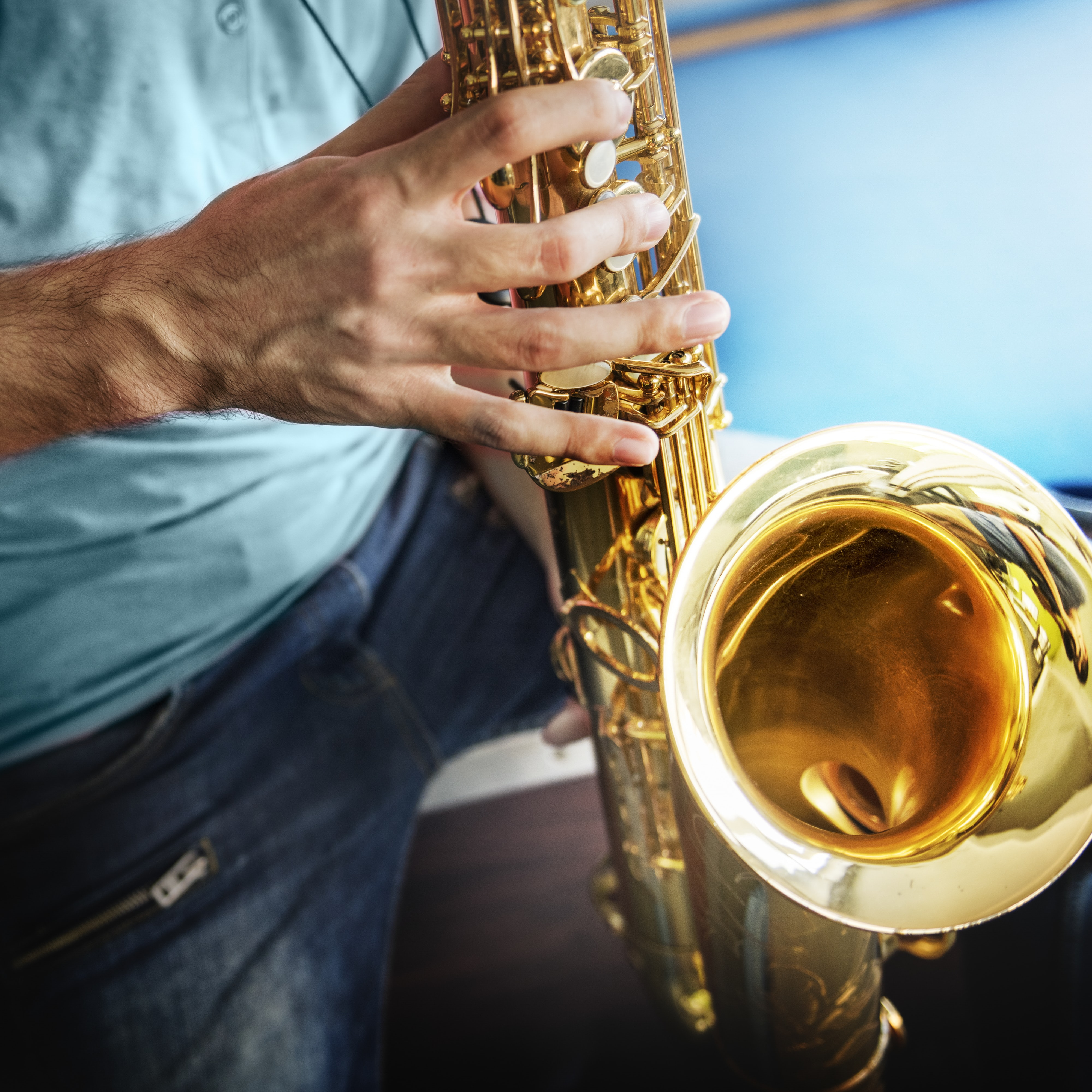 man showing saxophone