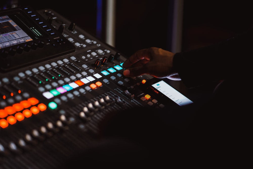 person using audio mixer