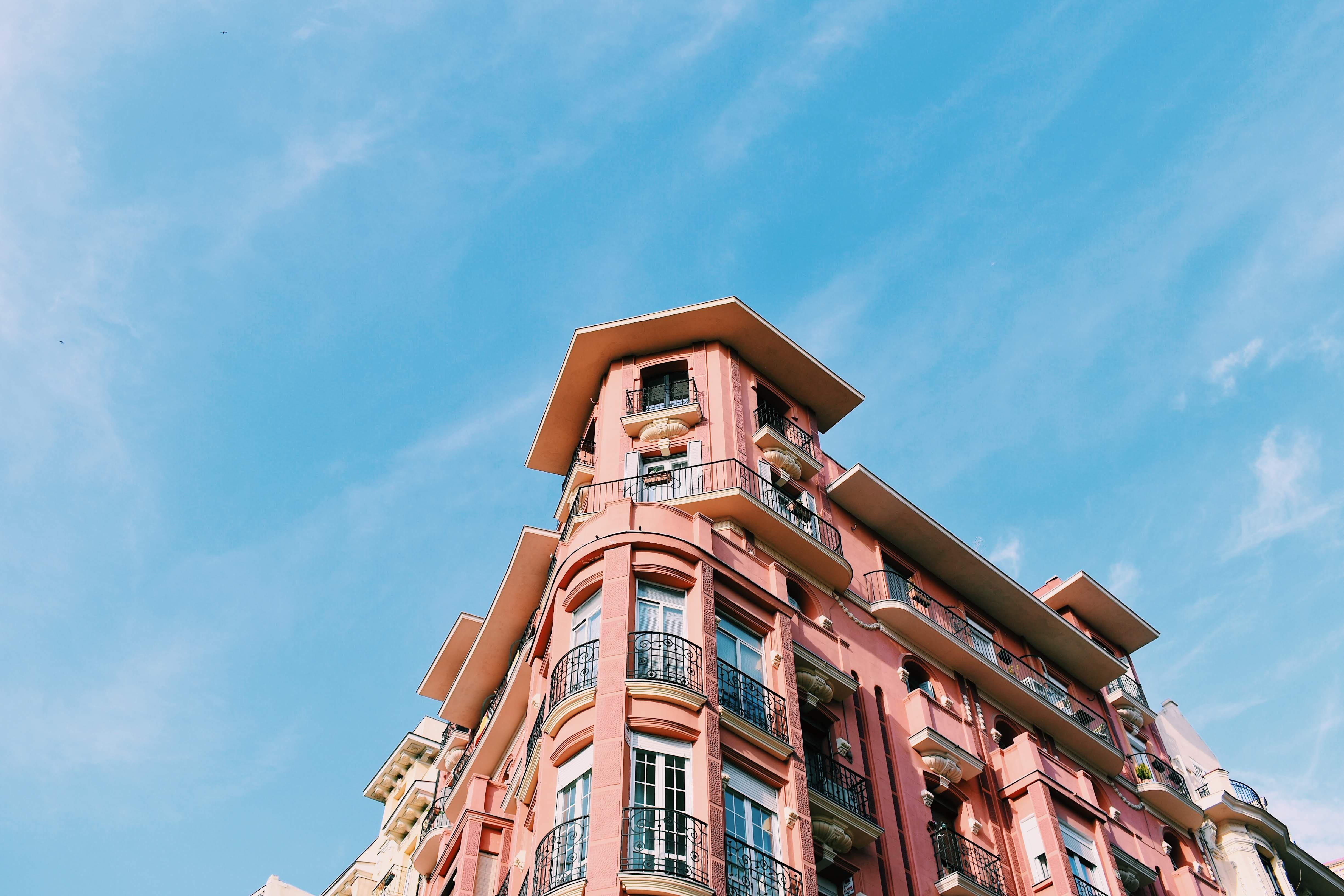 pink concrete building under blue sky