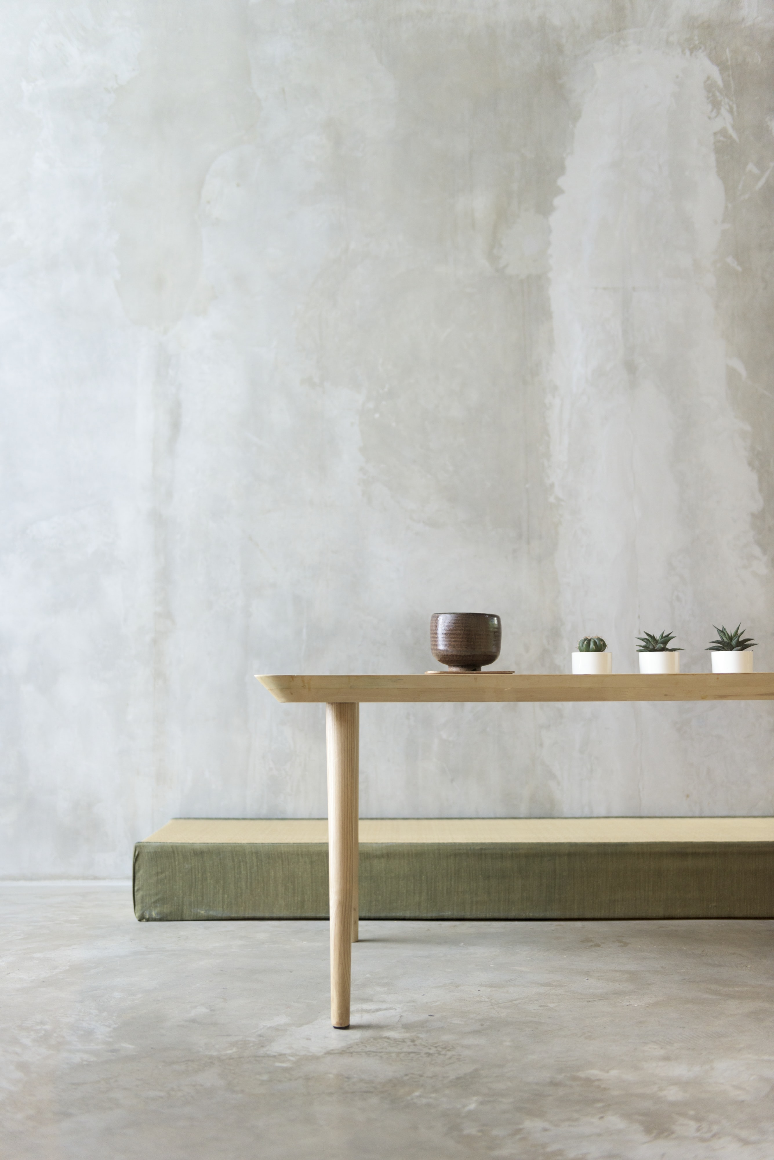 round brown ceramic bowl on beige wooden table