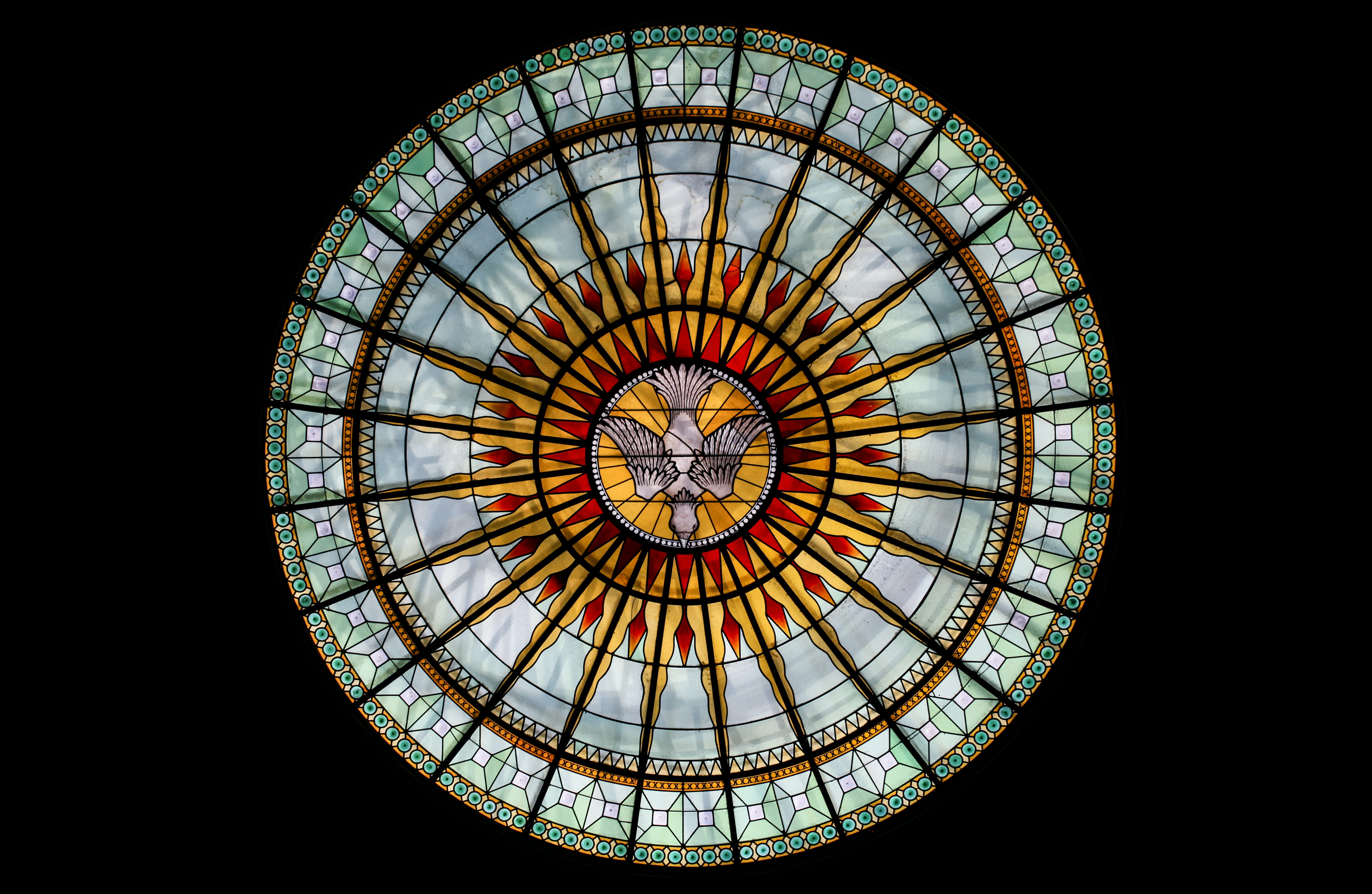 round white, beige, and red stained glass roofing