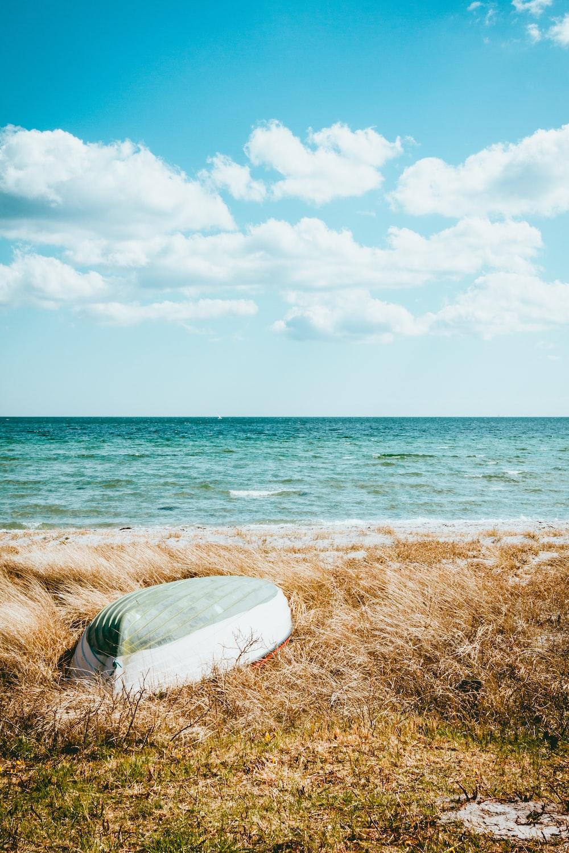 boat on beach under blue sky