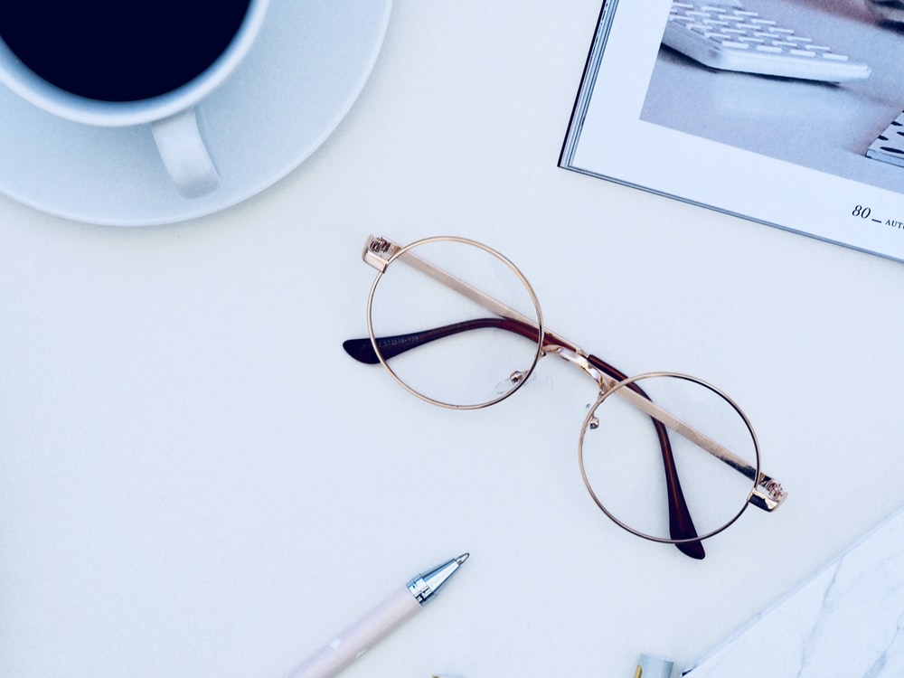 eyeglasses on white table