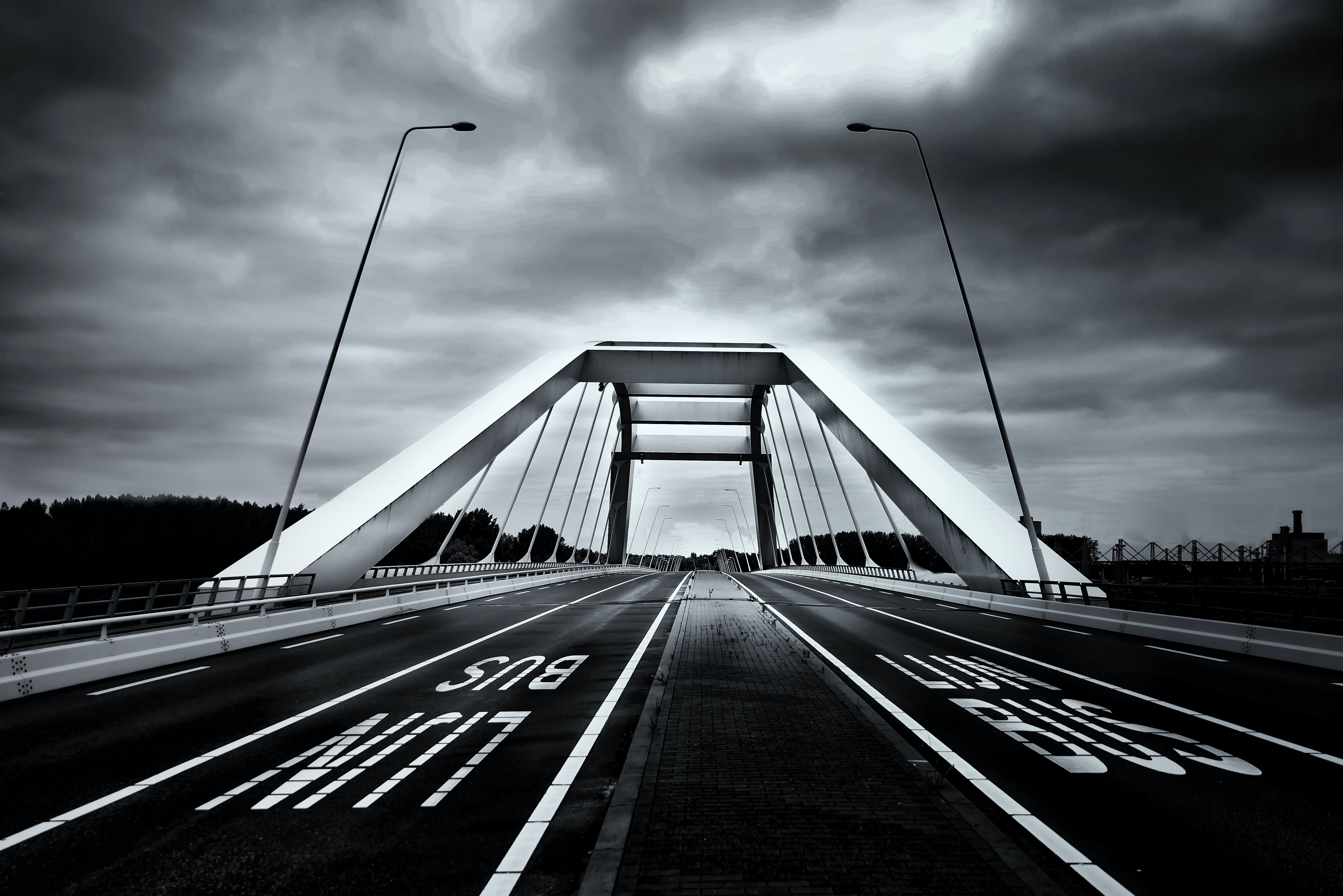 grayscale photography of Bus line bridge road
