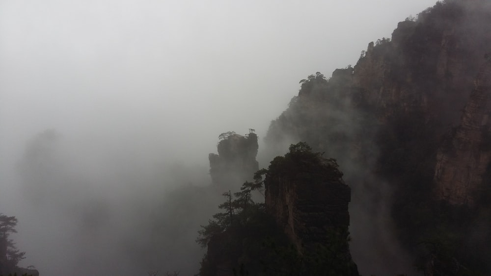 misty rock formation at daytime