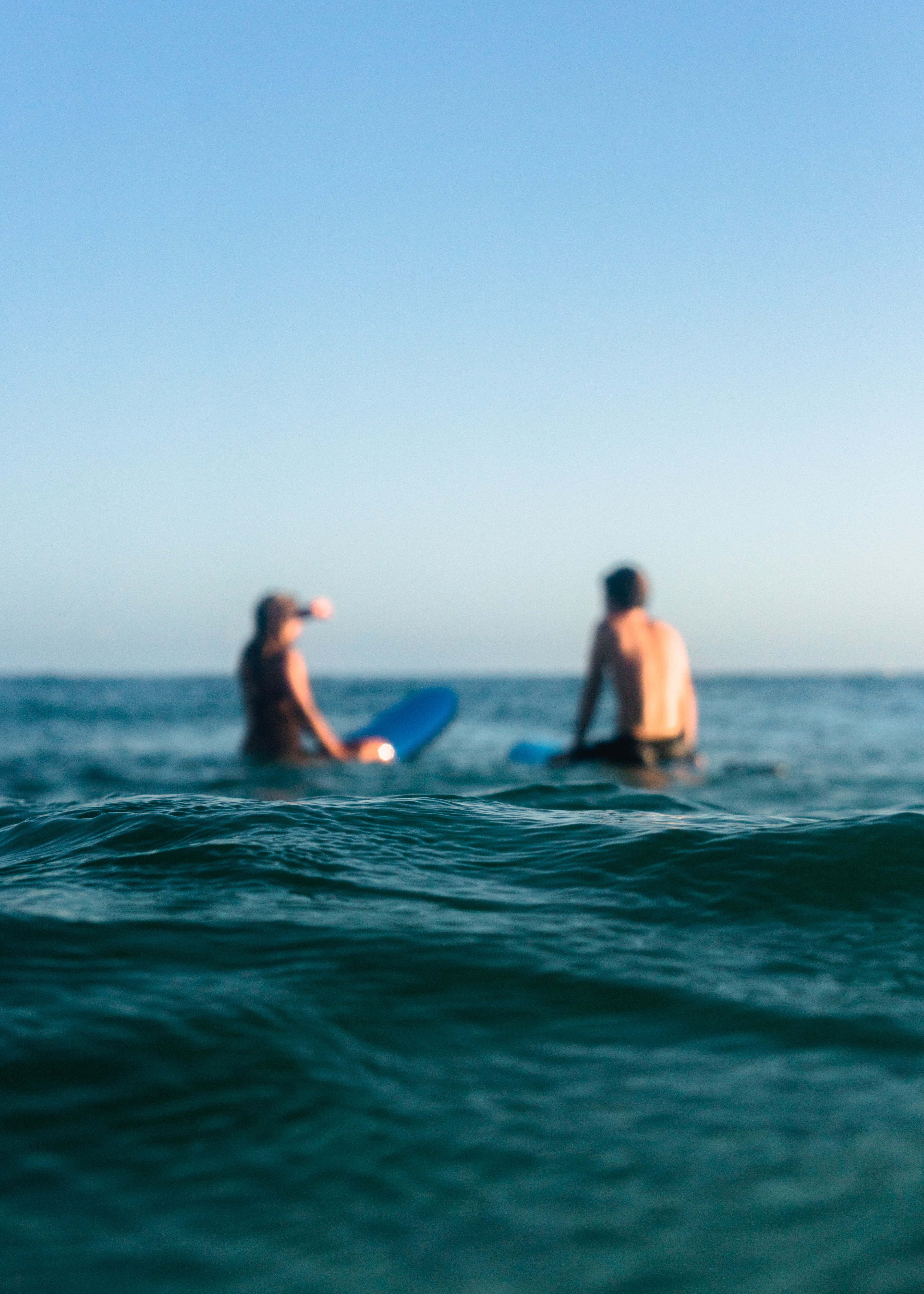 two surfer on ocean water during daytime