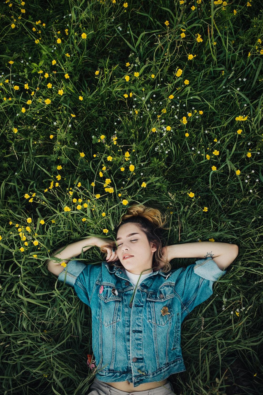 woman lying on grassland
