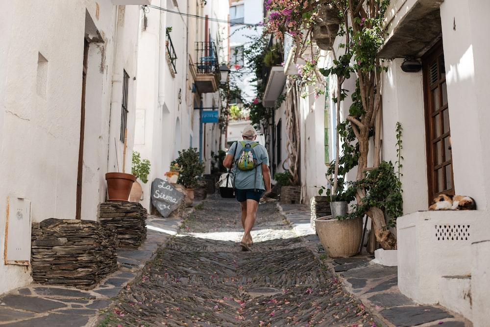 person walking on alleyway