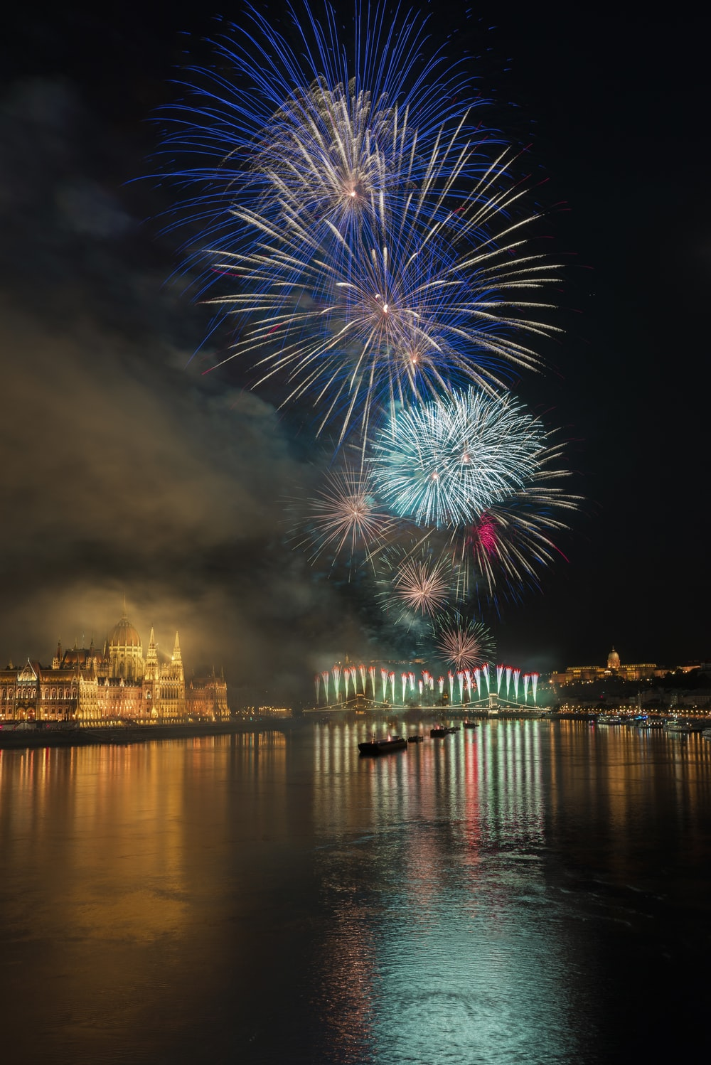 photo of fireworks above body of water