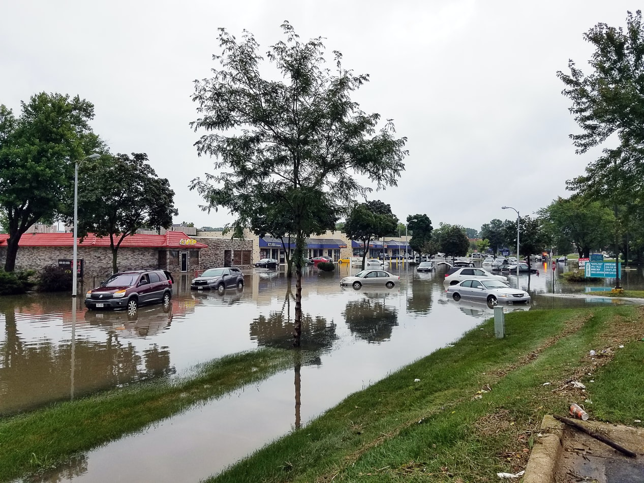 a flooded street with floating cars