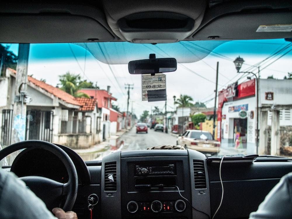 man holding steering wheel