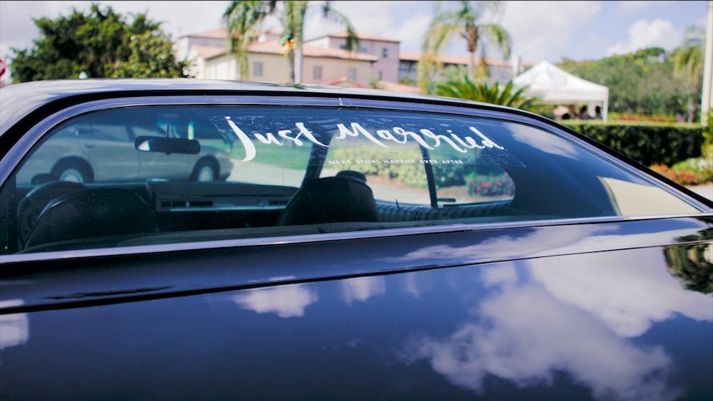black vehicle on road with just marries vinyl