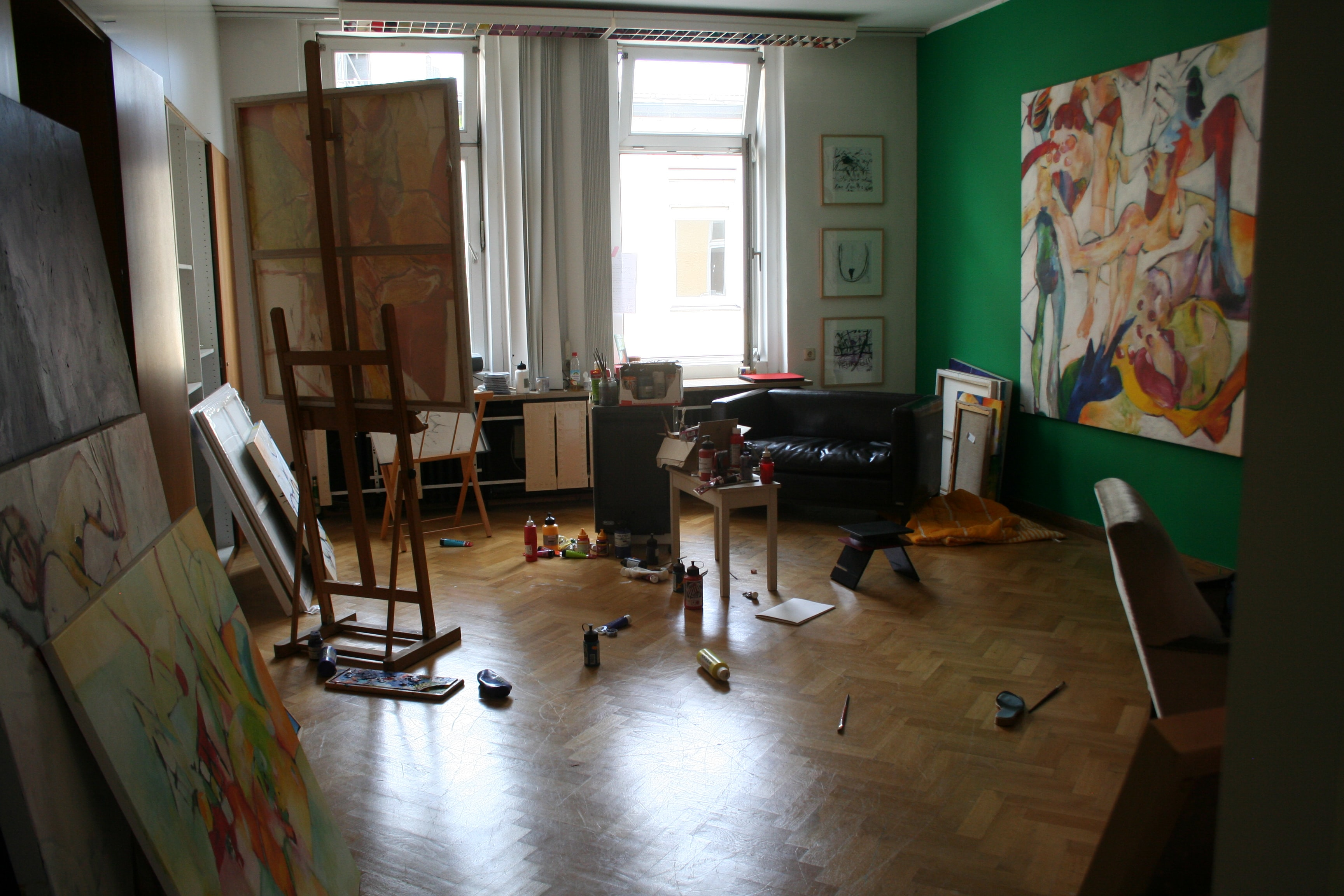 room filled with easel and canvas