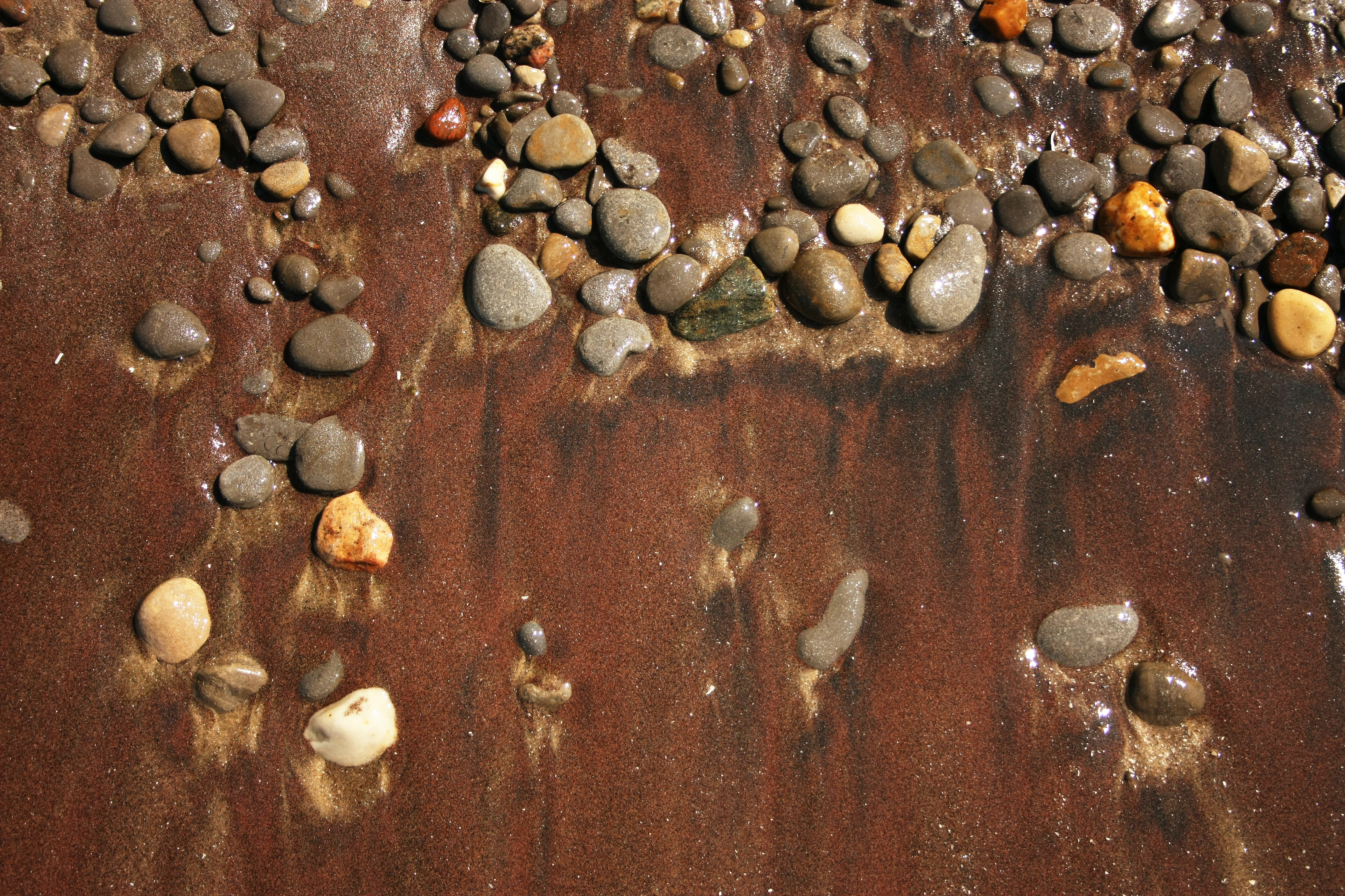 brown sand with stones