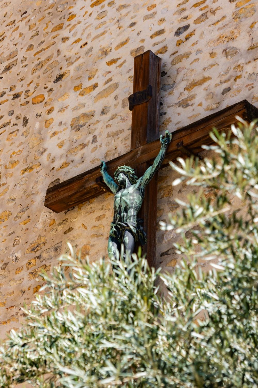 crucifix beside brown wall