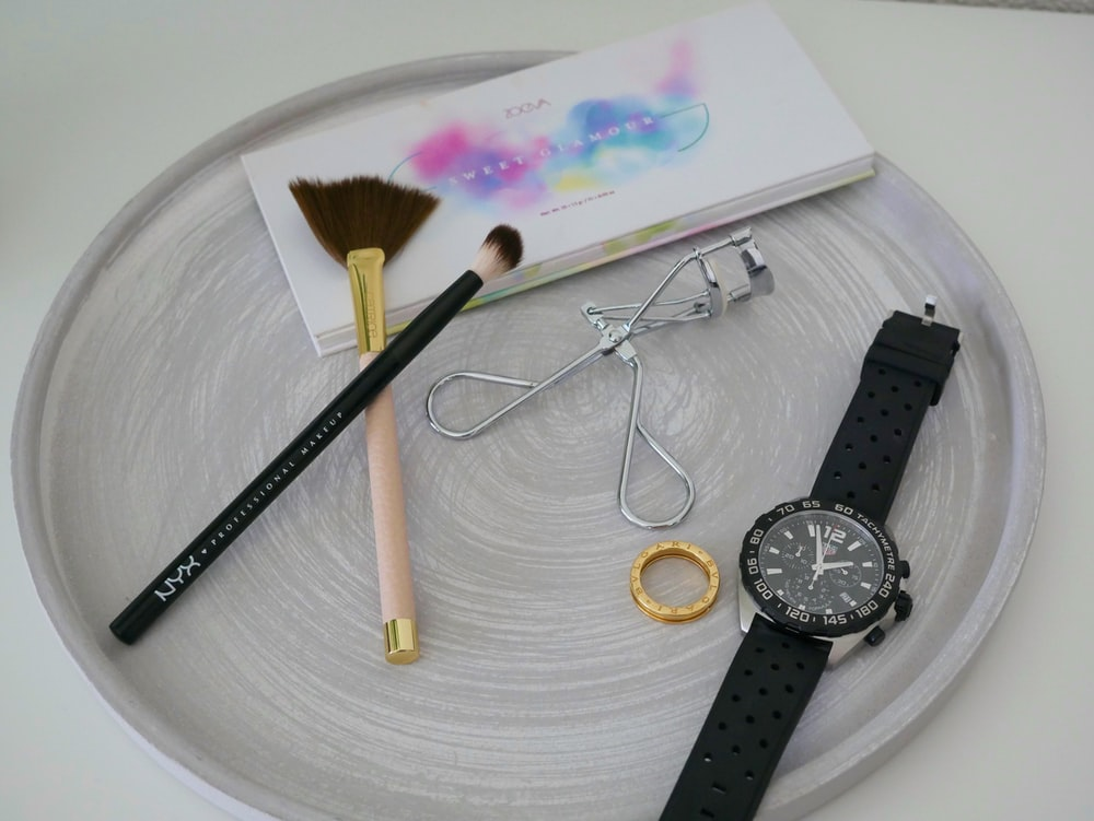black accessories on gray plate