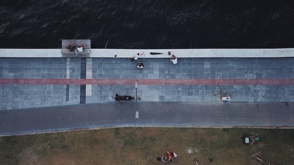 aerial photo of boardwalk near body of water