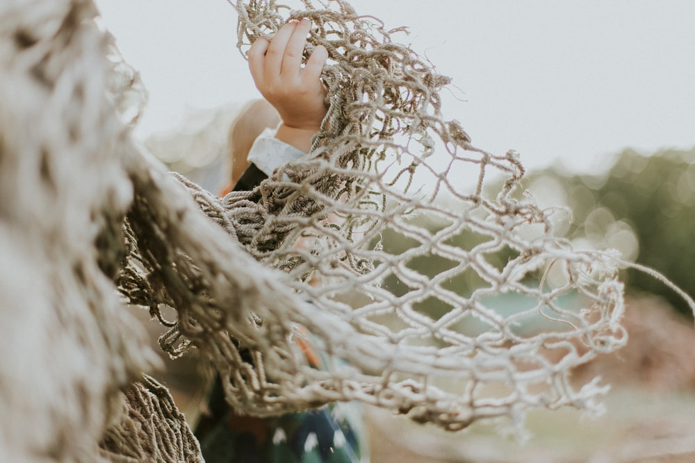 selective focus photography of white hammock
