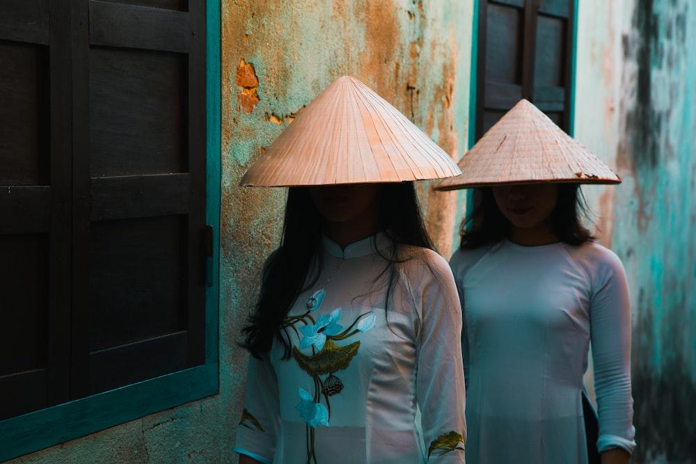 two women standing near window
