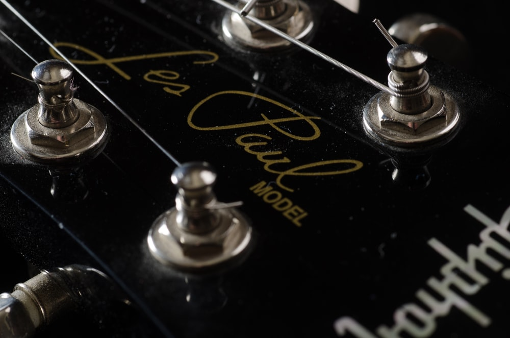black and gray Epiphone guitar headstock