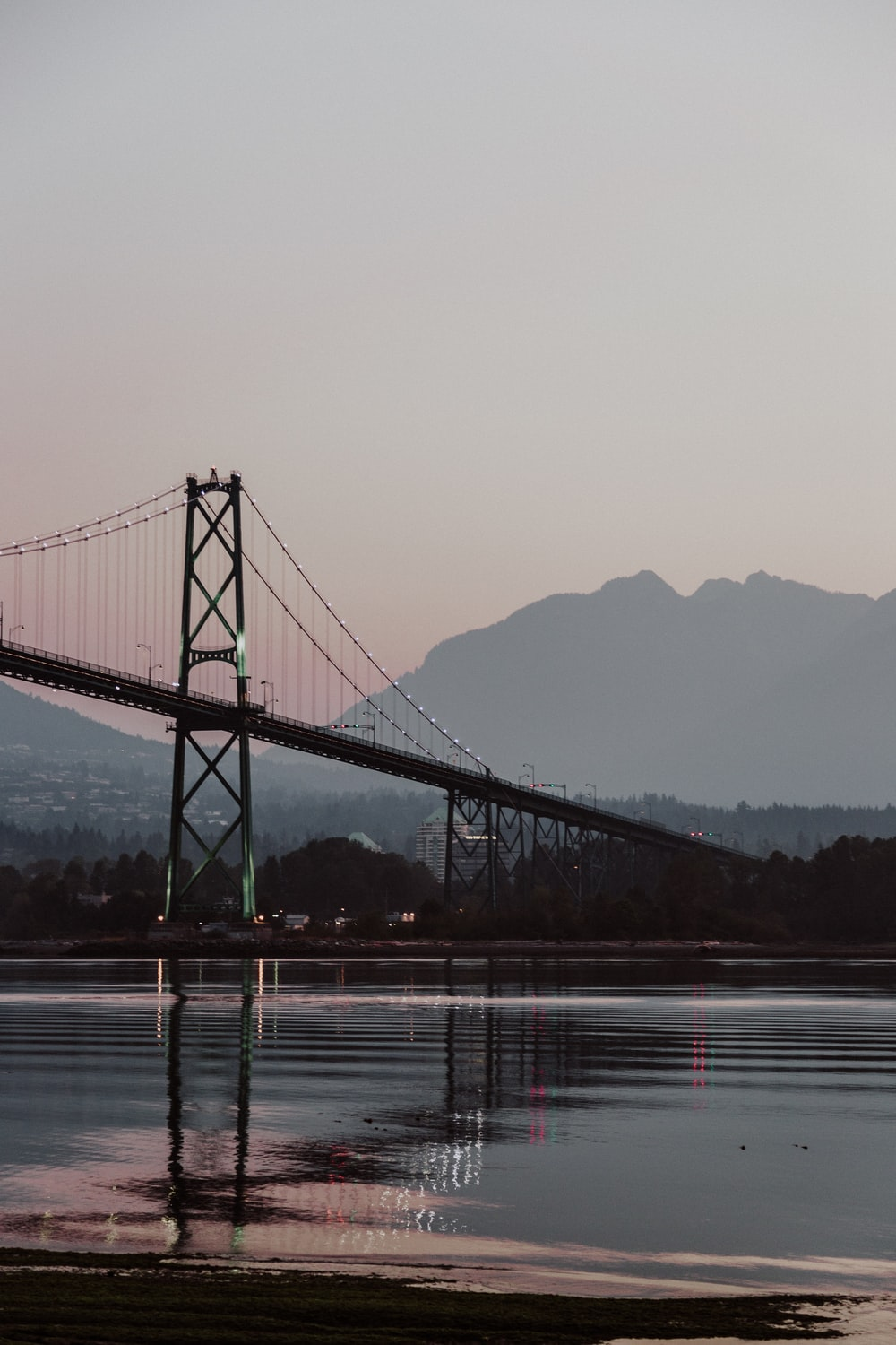 scenery of bridge in front of silhouette of mountain