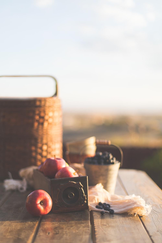 honey crisp apple beside baskets
