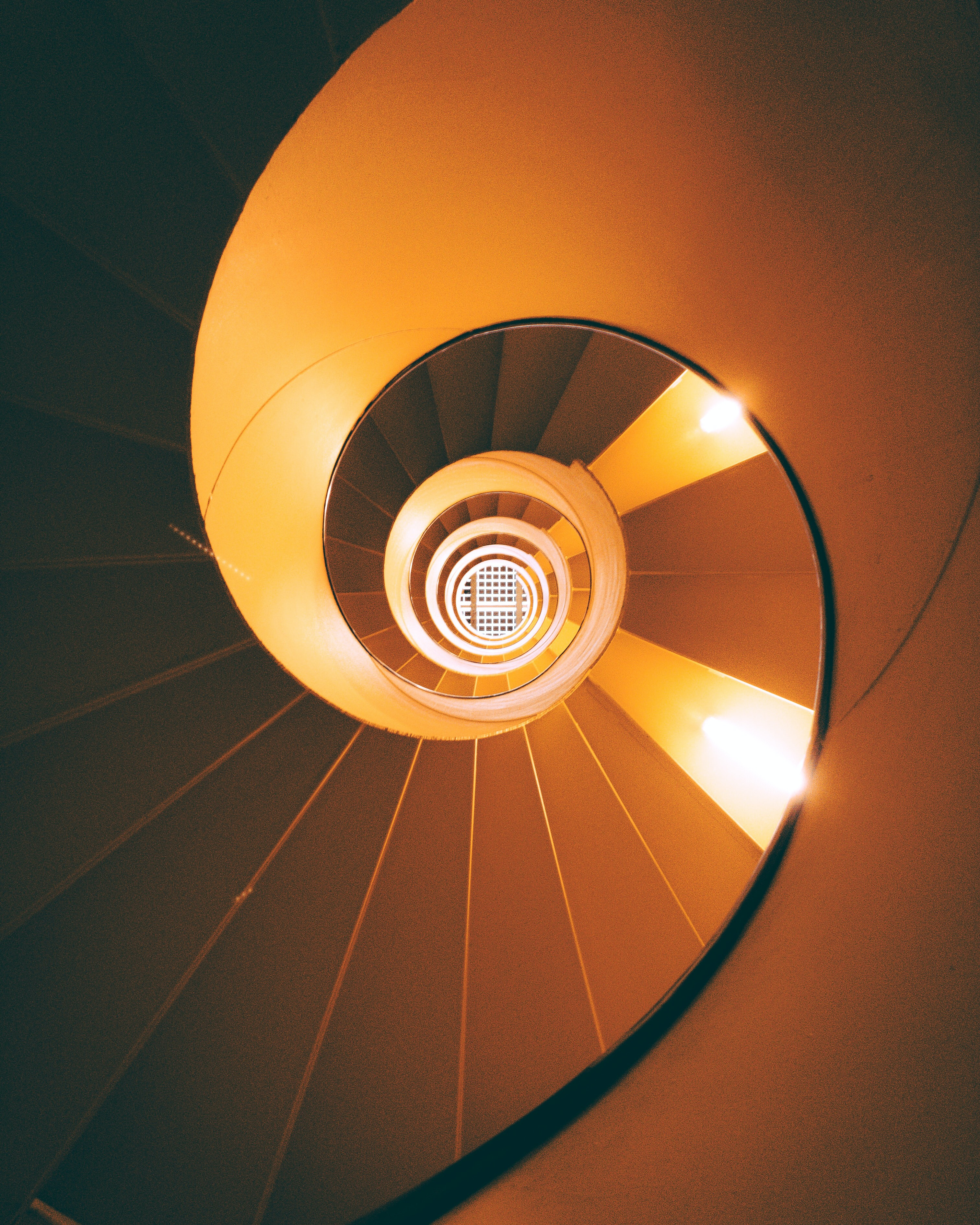 orange and brown spiral staircase