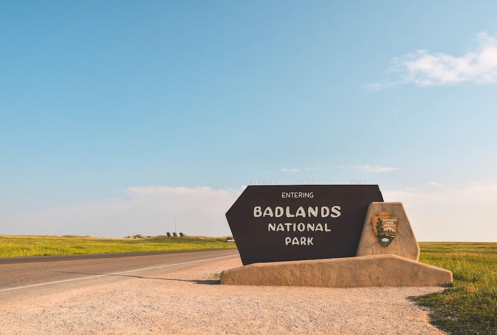 black Badlands National Park road sign beside road