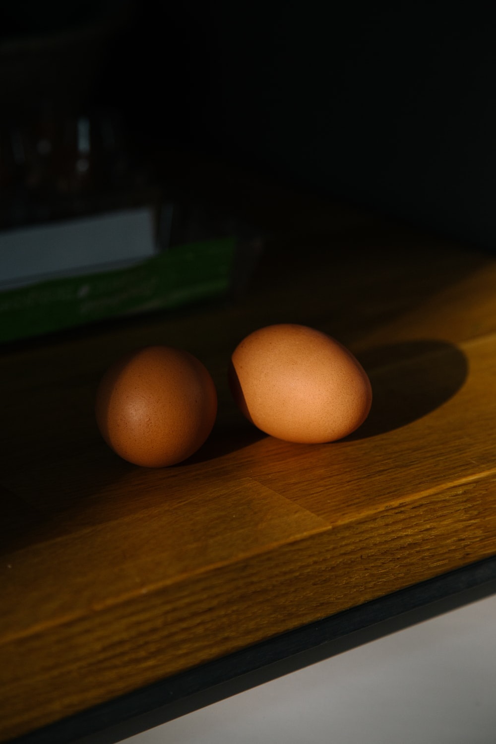 two organic eggs on brown table