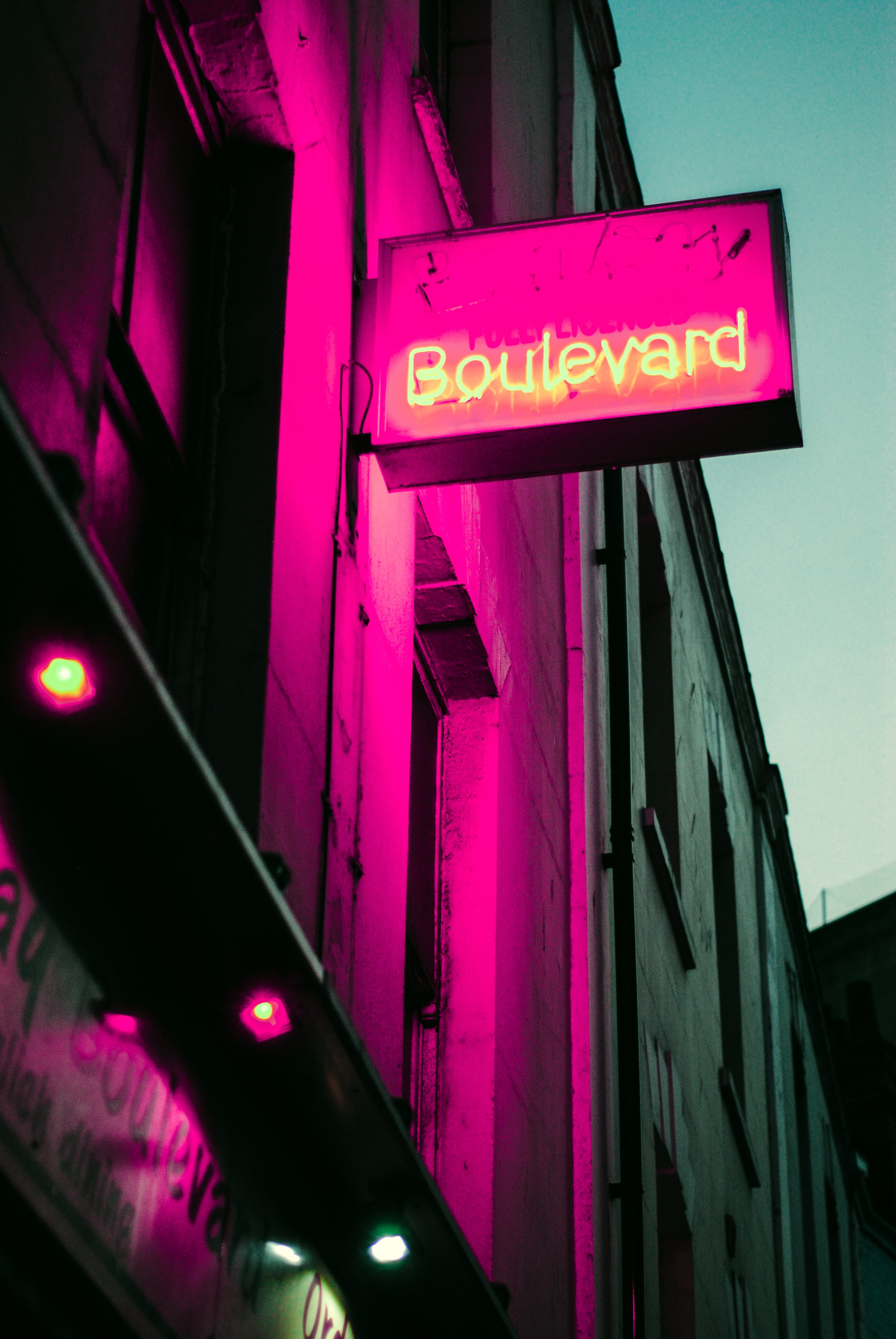 low angle photo of building with boulevard LED signage at night
