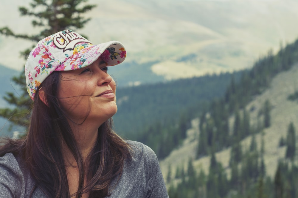 woman taking selfie on mountain