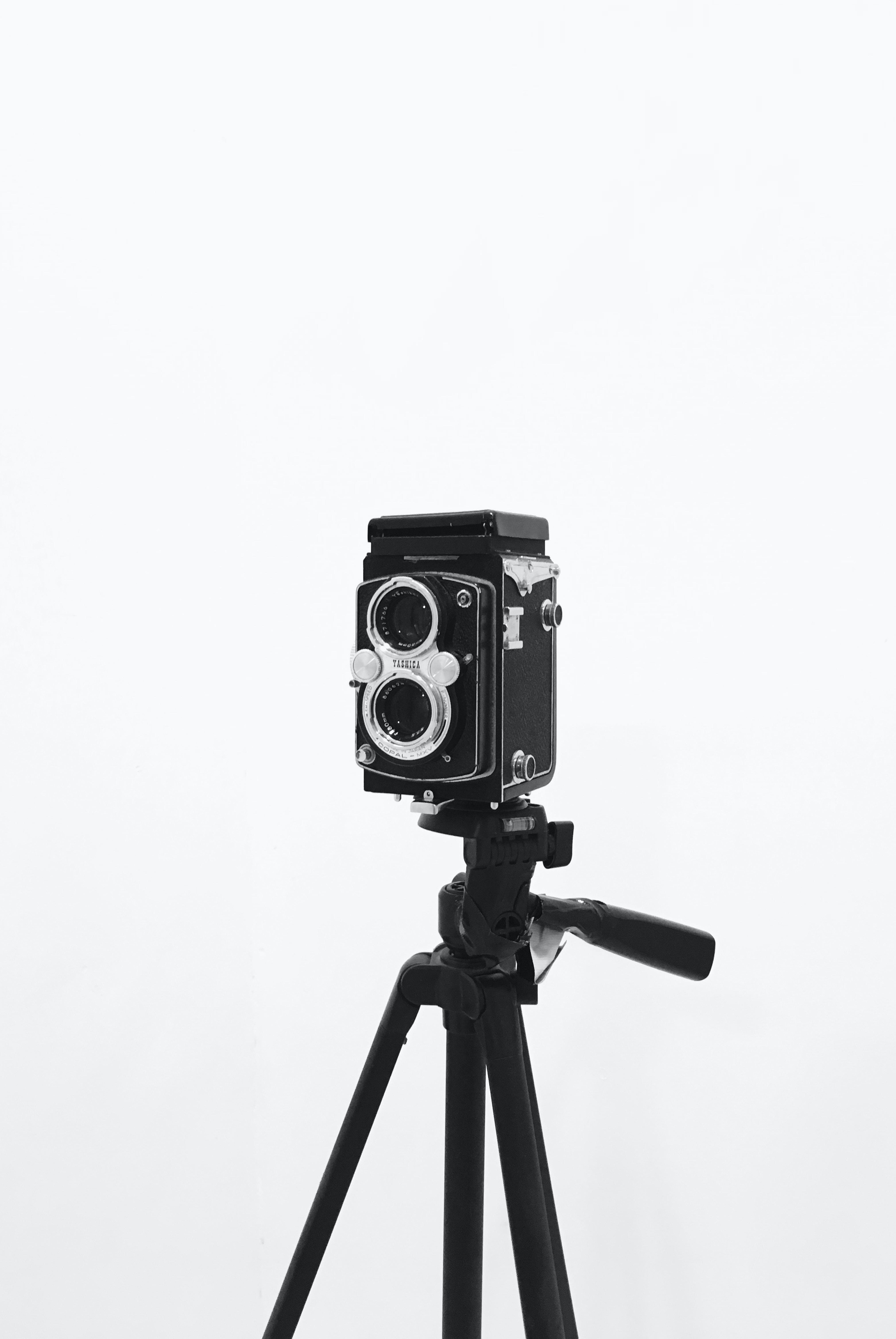 black and silver land camera on tripod