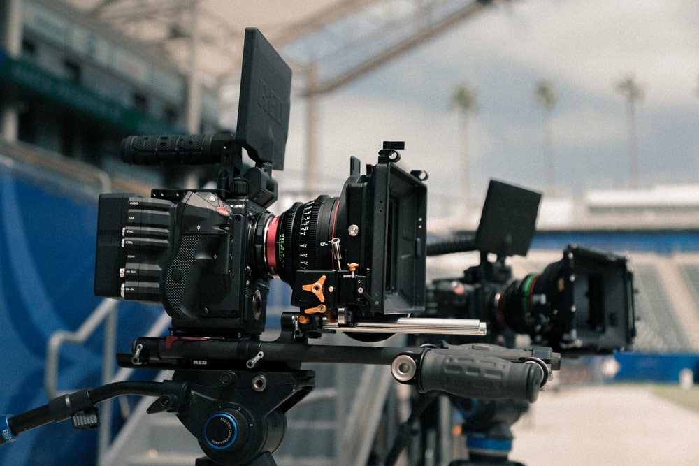 shallow focus photography of video camera