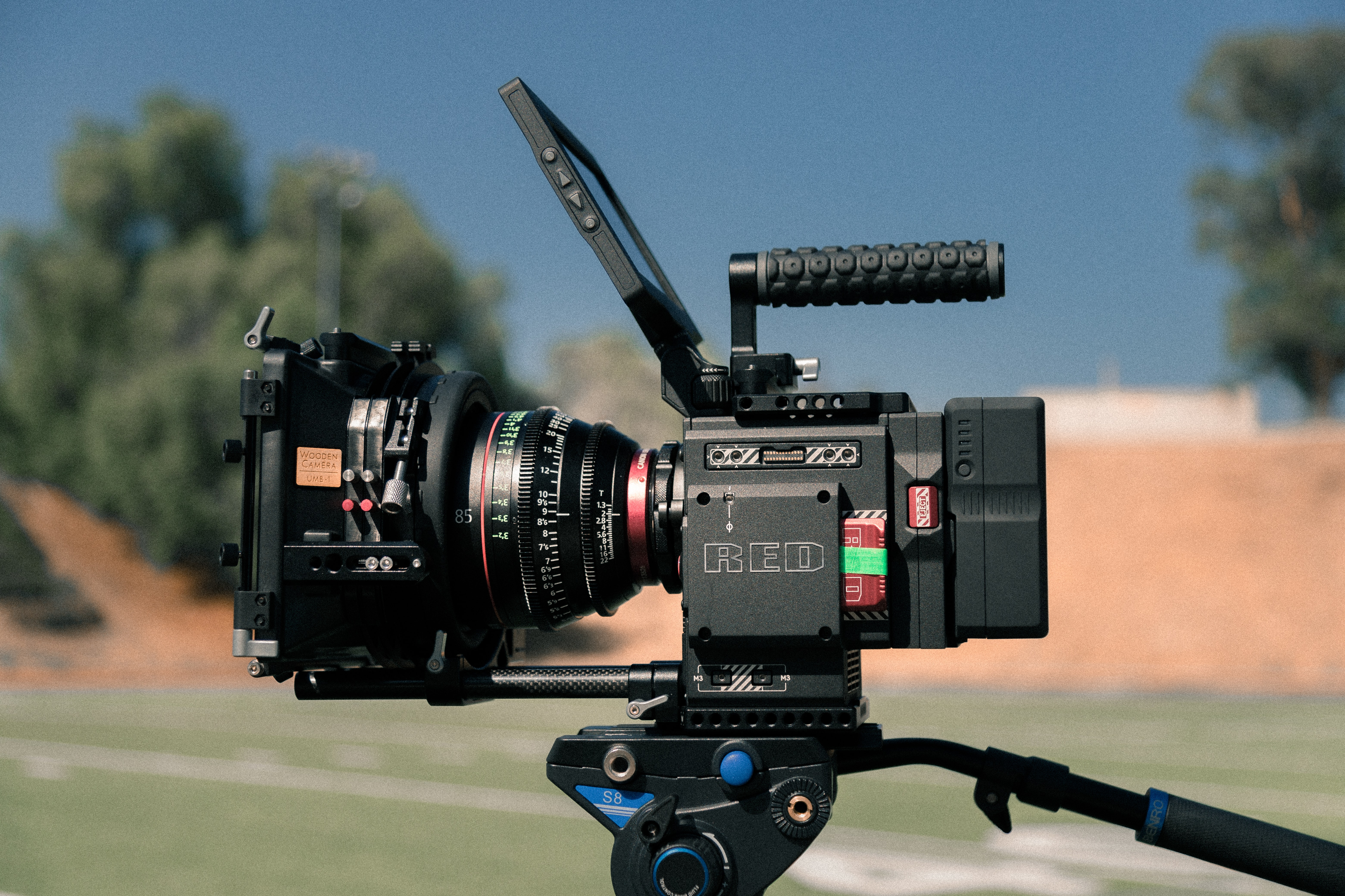 black digital video recorder on black tripod
