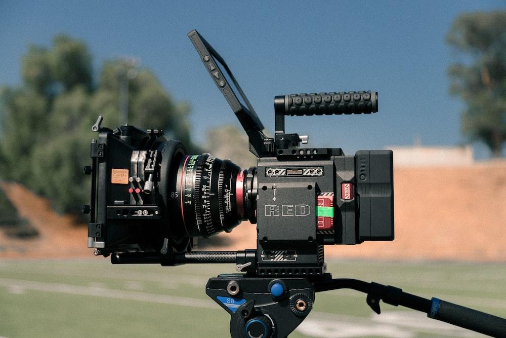 black digital video recorder on black tripod