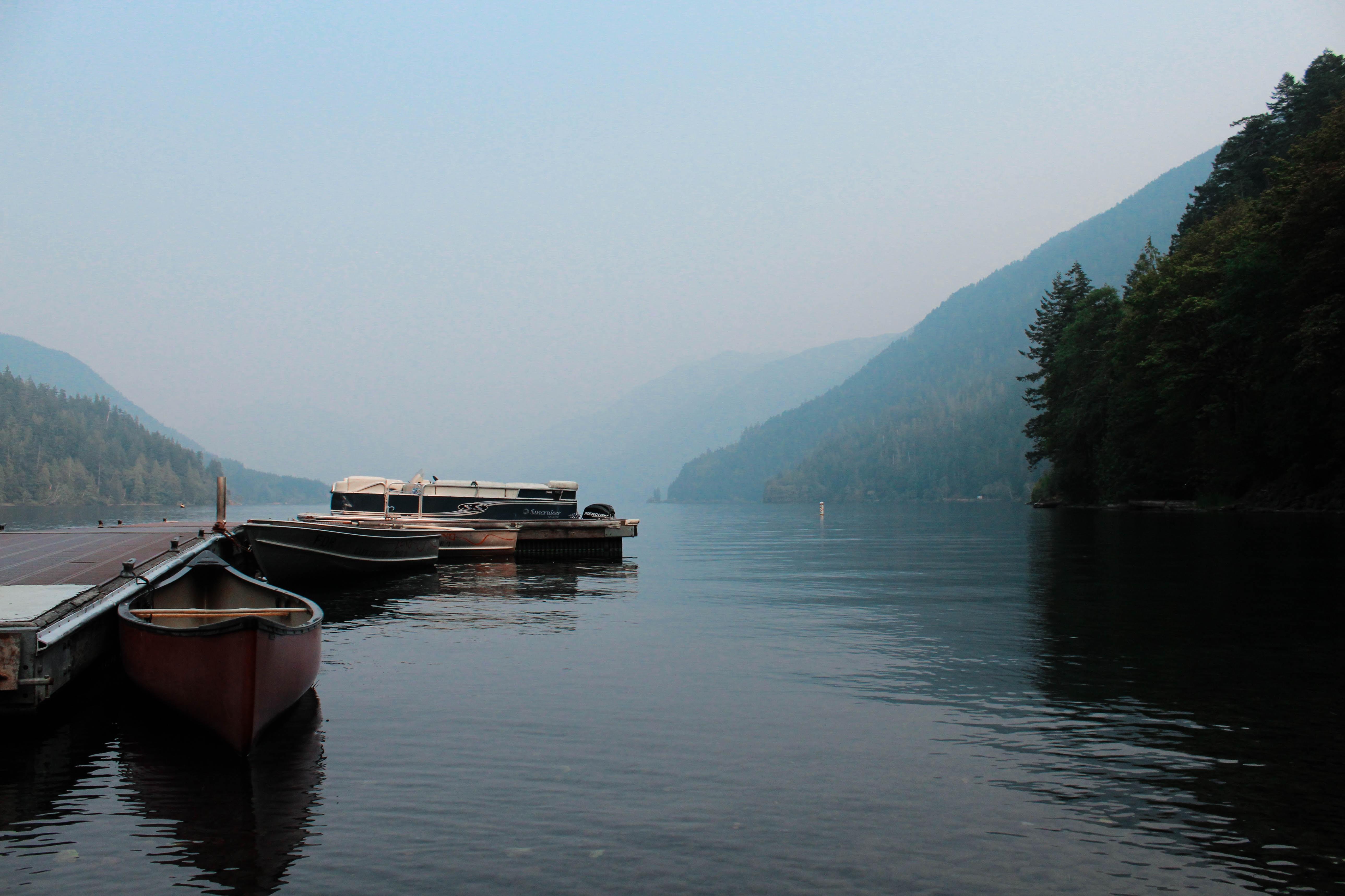 brown canoe docked under blue sky