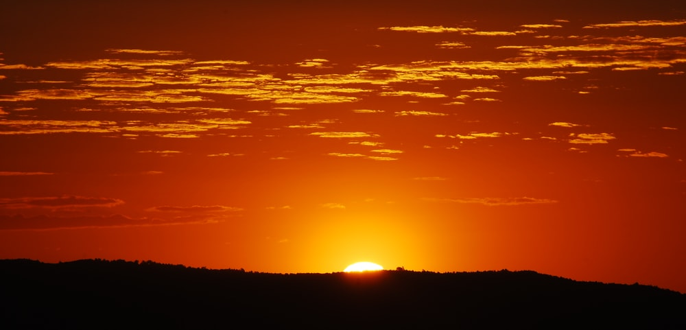 sunset behind mountain